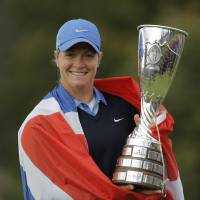 Photo - Suzann Pettersen of Norway poses with her trophy after winning the Evian Championship women's golf tournament in Evian, eastern France, Sunday, Sept. 15, 2013. (AP Photo/Laurent Cipriani)