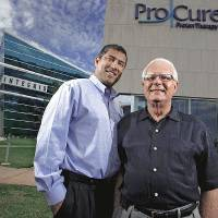 Photo - ProCure proton therapy center medical director Sameer Keole and patient Dick Marshall, from left, on Tuesday, July 6, 2010, in Oklahoma City, Okla.   Photo by Chris Landsberger, The Oklahoman ORG XMIT: KOD