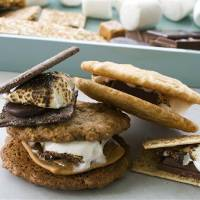 Photo - In this image taken on April 29, 2013, clockwise from top left, double chocolate grasshopper s'more, toasted mocha s'more, sesame caramel s'more and salted oatmeal s'more are shown in Concord, N.H. (AP Photo/Matthew Mead)