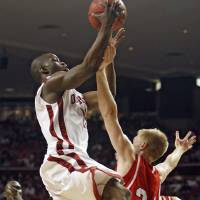 Photo - NIT SEASON TIP-OFF: OU's Willie Warren (13) goes over the top of Davidson's Bryant Barr (24) during the second half of the preseason NIT college basketball game between the University of Oklahoma and Davidson University on Tuesday, Nov. 18, 2008 at the Lloyd Noble Center in Norman, Okla.  STAFF PHOTO BY CHRIS LANDSBERGER  ORG XMIT: KOD