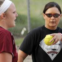 Photo - Coach Mandy Fulton gives instructions near catcher Jayci Wehrenberg, left, at practice for the OKC Strikkers softball team in Oklahoma City, Thursday, May 27, 2010.  Mandy Fulton was a member of OU's national championship softball team in 2000. Photo by Nate Billings, The Oklahoman ORG XMIT: KOD