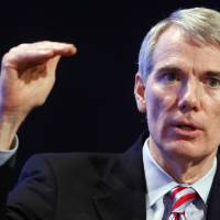 Photo - Sen. Rob Portman, R-Ohio, speaks about the budget at the 2013 Fiscal Summit in Washington, Tuesday, May 7, 2013. (AP Photo/Charles Dharapak)