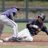 Photo - TCU third baseman Derek Odell, left, is unable to catch the throw as Pepperdine's Brandon Caruso (41) slides into third on a triple during the first inning of an NCAA college baseball tournament super regional game in Fort Worth, Texas, Monday, June 9, 2014. (AP Photo/Brandon Wade)