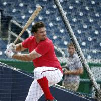 Photo - Washington Nationals third baseman Ryan Zimmerman bats during batting practice before the Nationals' baseball game against the Miami Marlins at Nationals Park on Wednesday, May 28, 2014, in Washington. Zimmerman is on the disabled list with a broken thumb, and was recently cleared to swing a bat. (AP Photo/Alex Brandon)