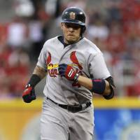 Photo - St. Louis Cardinals' Yadier Molina rounds the bases after hitting a solo home run off Cincinnati Reds starting pitcher Tony Cingrani in the fourth inning of a baseball game, Saturday, May 24, 2014, in Cincinnati. (AP Photo/Al Behrman)