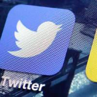 Photo - FILE - This Friday, Oct. 18, 2013, file photo shows a Twitter app on an iPhone screen, in New York. Twitter reports quarterly financial results on Tuesday, July 29, 2014. (AP Photo/Richard Drew, File)