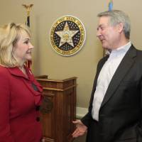 Photo - Gov. Mary Fallin and Secretary Robert Sommers talk before her cabinet meeting Dec. 11  at Capitol. Sommers is the secretary of education and workforce development. Photo by David McDaniel, The Oklahoman  David McDaniel - The Oklahoman
