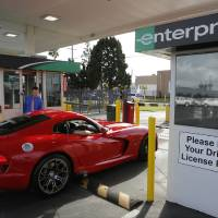 Photo - In this Wednesday, March, 26, 2014 photo, A rented 2013 Dodge Viper checks out at the Enterprise Exotic Car Collection showroom near Los Angeles International Airport. (AP Photo/Damian Dovarganes)