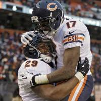 Photo - Chicago Bears running back Michael Bush (29) celebrates with wide receiver Alshon Jeffery (17) after Bush ran 40 yards for a touchdown against the Cleveland Browns in the fourth quarter of an NFL football game Sunday, Dec. 15, 2013, in Cleveland. The Bears won 38-31. (AP Photo/Tony Dejak)