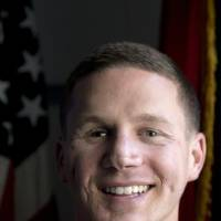 Photo - This photo taken May 13, 2014 shows Medically retired Marine Lance Cpl. Kyle Carpenter speaking to media at the Pentagon. On June 19, 2014, President Barack Obama will award Carpenter the Medal of Honor for his courageous actions while serving as an Automatic Rifleman with Company F, 2d Battalion, 9th Marines, Regimental Combat Team 1, 1st Marine Division (Forward), I Marine Expeditionary Force (Forward), in Helmand Province, Afghanistan. (AP Photo/Carolyn Kaster)