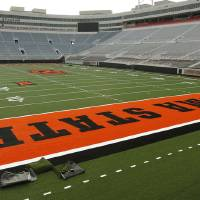 Photo - New football turf being installed inside OSU's Boone Pickens Stadium in Stillwater, Okla., Friday, June 6, 2014. Photo by Nate Billings, The Oklahoman