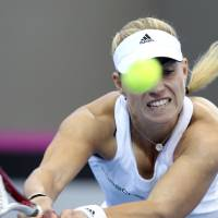 Photo - Angelique Kerber of Germany plays a shot in her match against Samantha Stosur of Australia during the Fed Cup semifinals between Australia and Germany in Brisbane, Australia, Sunday, April 20, 2014. (AP Photo/Tertius Pickard)