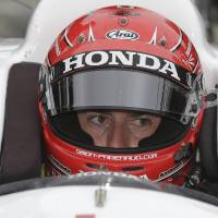Photo - Simon Pagenaud, of France, sits in his car as he waits to practice for the Indianapolis 500 IndyCar auto race at Indianapolis Motor Speedway in Indianapolis, Wednesday, May 14, 2014. (AP Photo/Darron Cummings)