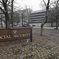 Photo - FILE - This Jan. 11, 2013, file photo shows the Social Security Administration's main campus in Woodlawn, Md. A new congressional report says the Social Security Administration has been closing a record number of field offices, even as millions of baby boomers approach retirement. The agency blames budget constraints. As a result, seniors seeking information and help from the agency are facing increasingly long waits _ in person and on the phone. (AP Photo/Patrick Semansky, File)