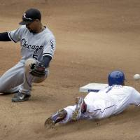 Photo - Texas Rangers' Elvis Andrus (1) steals second safely  as Chicago White Sox second baseman Marcus Semien is unable to handle the throw from catcher Tyler Flowers in the fourth inning of a baseball game, Sunday, April 20, 2014, in Arlington, Texas. Andrus then advanced to third. (AP Photo/Tony Gutierrez)