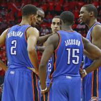 Photo - NBA BASKETBALL: Oklahoma City's Thabo Sefolosha (2), Reggie Jackson (15), Kevin Durant (35). Serge Ibaka (9), second from left, and Kevin Martin (23), center, talk during a timeout in Game 6 in the first round of the NBA playoffs between the Oklahoma City Thunder and the Houston Rockets at the Toyota Center in Houston, Texas, Friday, May 3, 2013. Oklahoma City won 103-94. Photo by Bryan Terry, The Oklahoman