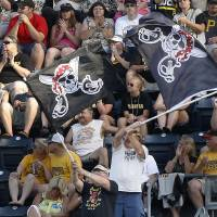 Photo - In this photo from Sunday, June 30, 2013, Pittsburgh Pirates fans waves