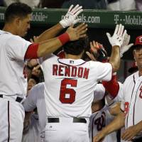 Photo - Washington Nationals' Anthony Rendon (6) celebrates his two-run homer during the sixth inning of an interleague baseball game against the Baltimore Orioles at Nationals Park, Monday, July 7, 2014, in Washington. (AP Photo/Alex Brandon)