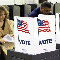 Photo -   Voters cast their ballots on Election Day Tuesday, Nov. 6, 2012 in Riverton, Ill. (AP Photo/Seth Perlman)
