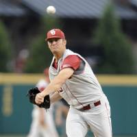 Photo - Oklahoma's pitcher Jordan John throws against South Carolina in the first inning of an NCAA college super regional baseball tournament game in Columbia, S.C., Saturday, June 9, 2012. (AP Photo/Mary Ann Chastain) ORG XMIT: SCMC108