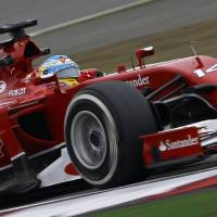 Photo - Ferrari driver Fernando Alonso of Spain steers his car during a practice session ahead of Sunday's Chinese Formula One Grand Prix at Shanghai International Circuit in Shanghai, China, Friday, April 18, 2014. (AP Photo/Alexander F. Yuan)