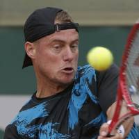 Photo - Australia's Leyton Hewitt returns the ball during the first round match of the French Open tennis tournament against Argentina's Carlos Berlocq at the Roland Garros stadium, in Paris, France, Tuesday, May 27, 2014. (AP Photo/Michel Euler)