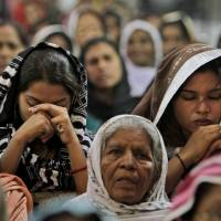 Photo -   Pakistani Christians pray for the recovery of 14-year-old schoolgirl Malala Yousufzai, who was shot last Tuesday by a Taliban gunman for speaking out in support of education for women, at the Sacred Heart Cathedral Church in Lahore, Pakistan, Sunday, Oct. 14, 2012. The United Arab Emirates plans to send a specialized aircraft to serve as an ambulance for Yousufzai in case doctors decide to send her abroad for treatment, a Pakistani official said Sunday. (AP Photo/K.M. Chaudary)