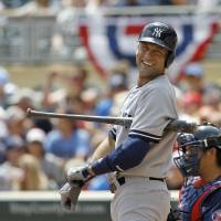 Photo - New York Yankees'  Derek Jeter looks to third base coach Rob Thomson during the first inning of a baseball game against the Minnesota Twins in Minneapolis, Sunday, July 6, 2014. (AP Photo/Ann Heisenfelt)