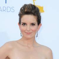 Photo -   FILE - In this Sept. 23, 2012 file photo, actress Tina Fey arrives at the 64th Primetime Emmy Awards at the Nokia Theatre, in Los Angeles. The Hollywood Foreign Press Association, dick clark productions and NBC announced Monday, Oct. 15, 2012, that Tina Fey and Amy Poehler, have signed on to host the 70th annual ceremony after British comedian Ricky Gervais' three-year reign as the ceremony's acerbic master of ceremonies. The Golden Globes are set to air on NBC on Jan. 13, 2013. (Photo by Jordan Strauss/Invision/AP, File)