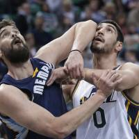 Photo - Memphis Grizzlies' Marc Gasol, left, of Spain, and Utah Jazz's Enes Kanter (0), of Turkey, wait for a rebound in the first quarter of an NBA basketball game Wednesday, March 26, 2014, in Salt Lake City. (AP Photo/Rick Bowmer)