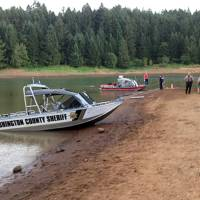 Photo - This photo provided by the Washington County, Ore., Sheriff's Office shows a search underway Tuesday, Aug. 26, 2014, for family members of a child who apparently drowned Monday at Henry Hagg Lake, a reservoir in Gaston, Ore., west of Portland.