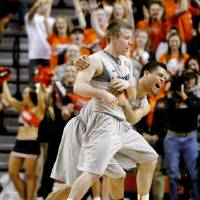 Photo - Oklahoma State's Keiton Page (12) and Cezar Guerrero (1) celebrate during an NCAA college basketball game between Oklahoma State University (OSU) and the University of Texas (UT) at Gallagher-Iba Arena in Stillwater, Okla., Saturday, Feb. 18, 2012. Oklahoma State won 90-78. Photo by Bryan Terry, The Oklahoman