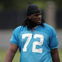 Photo -  Carolina Panthers'  Duke Robinson (72), the Panther's 5th round draft pick, walks off the field after football minicamp on Friday, May 1, 2009 in Charlotte, N.C. (AP Photo/Rick Havner) ORG XMIT: NCRH102