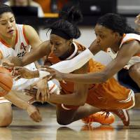 Photo - From left, Oklahoma State's Brittney Martin (22), Texas' Empress Davenport (1) and Oklahoma State's Toni Young (15) chase a loose ball during a women's college basketball game between Oklahoma State University (OSU) and the University of Texas at Gallagher-Iba Arena in Stillwater, Okla., Saturday, March 2, 2013. Photo by Nate Billings, The Oklahoman