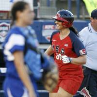 Photo - U.S. / UNITED STATES: Jenae Leles of the United States runs the bases past Ilaria Pino of Italy after Leles hit a three-run home run in the third inning during the game between the USA and Italy in the World Cup of Softball at ASA Hall of Fame Stadium in Oklahoma City, Friday, July 17, 2009. By Nate Billings, The Oklahoman ORG XMIT: KOD