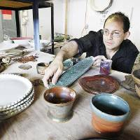 Photo - Instructor Matt Murray shows finished items made by students in his ceramics class at the  Oklahoma Contemporary Art Center. Photo by Paul B. Southerland, The Oklahoman  PAUL B. SOUTHERLAND - PAUL B. SOUTHERLAND