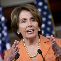 Photo - House Minority Leader Nancy Pelosi of Calif. gestures as she meets with reporters during a news conference on Capitol Hill in Washington, Thursday, Dec. 13, 2012. Pelosi questions why the fiscal cliff negotiations are going to the last minute.  (AP Photo/J. Scott Applewhite)
