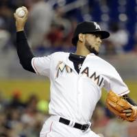 Photo - Miami Marlins starting pitcher Henderson Alvarez throws during the first inning of an interleague baseball game against the Tampa Bay Rays, Tuesday, June 3, 2014, in Miami. (AP Photo/Lynne Sladky)