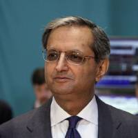 Photo -   FILE - In a Monday, June 18, 2012 file photo, Citigroup CEO Vikram Pandit prepares for a television interview on the floor of the New York Stock Exchange, after he rang the opening bell. Citigroup Inc. says Tuesday, Oct. 16, 2012 that Pandit is stepping down as CEO and a board member. The New York bank's new CEO will be Michael Corbat, the CEO of the company's Europe, Middle East and Africa division. (AP Photo/Richard Drew, File)