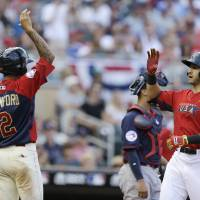 Photo - United States' Joey Gallo, right, celebrates with teammate J.P. Crawford, left, after hitting a two-run home run during the sixth inning of the All-Star Futures baseball game against Team World, Sunday, July 13, 2014, in Minneapolis. (AP Photo/Jeff Roberson)