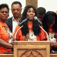 Photo - Alice Williams, middle, speaks about her son, Darrell Williams, during a rally in support of him at Mt. Zion Baptist Church in Stillwater on Thursday.  Photo by Nate Billings, The Oklahoman