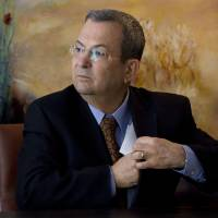 Photo -   In this Monday Jan. 17, 2011 file photo, Israeli Defense Minister Ehud Barak attends a press conference in the Knesset, Israel's parliament, in Jerusalem. Israeli Defense Minister Ehud Barak shook up the Israeli political system Monday with the abrupt announcement that he is quitting politics and will not run in general elections in January. The defense minister made the surprise announcement even after polls showed his breakaway Independence Party gaining momentum after Israel's recent military offensive in the Gaza Strip. (AP Photo/Bernat Armangue, File)