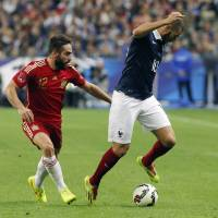 Photo - France's Karim Benzema, right, vies for the ball with Spain's Daniel Carvajal during their international friendly soccer match at the Stade de France in Saint Denis, outside Paris, Thursday, Sept. 4, 2014. (AP Photo/Thibault Camus)