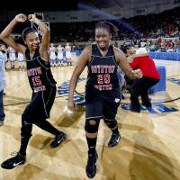 Photo - BOYNTON-MOTON / GIRLS HIGH SCHOOL BASKETBALL / CELEBRATION: Boynton's Sherri Lang, left, and Shawonda Lang celebrate their win over Cyril in  finals of girls Class B basketball state tournament  at the State Fair Arena, Saturday, March 6, 2010, in Oklahoma City. Photo by Sarah Phipps, The Oklahoman  ORG XMIT: KOD