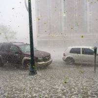Photo - A hail storm hits downtown Colorado Springs, Colo., Wednesday, May 21, 2014. (AP Photo/The Gazette, Christian Murdock) MAGAZINES OUT.