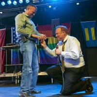 Photo - Utah Sen. Jim Dabakis, D-Salt Lake City, proposes to Stephen Justesen, his boyfriend of over twenty-five years, during a party at Club Sound Wednesday June 26, 2013 in Salt Lake City. Dabakis said the proposal was a spur-of-the-moment decision and a wedding date has not been set.  In historic decisions, the U.S. Supreme Court handed gay-rights supporters major victories Wednesday, extending federal rights to same-sex couples and reversing a ban on gay marriage in California.  (AP Photo/The Salt Lake Tribune, Chris Detrick)