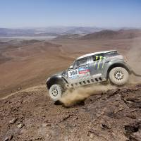 Photo - Mini driver Stephane Peterhansel and co-pilot Jean Paul Cottret, both of France, drive down a mountain during the eleventh stage of the Dakar Rally between the cities of Antofagasta and El Salvador, Chile, Thursday, Jan. 16, 2014. (AP Photo/Victor R. Caivano)