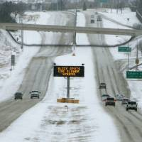 Photo - A lighted sign warns drivers of road conditions on the Kilpatrick Turnpike in Oklahoma City, OK, Friday, December 6, 2013,  Photo by Paul Hellstern, The Oklahoman