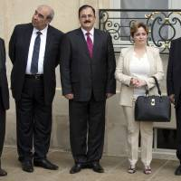 Photo - Members of the Syria National Coalition, from left, Farouk Tayfour, Michel Kilo, Salem Idriss, Suheir Atassi, and Burhan Ghalioun wait for the meeting of France's president Francois Hollande and Syria National Coallition president Ahmed al-Jarba at the Elysee Palace in Paris, France, Wednesday, July 24, 2013. (AP Photo/Francois Mori)