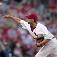 Photo -   St. Louis Cardinals starting pitcher Adam Wainwright throws during the first inning of a baseball game against the San Diego Padres on Tuesday, May 22, 2012, in St. Louis. (AP Photo/Jeff Roberson)